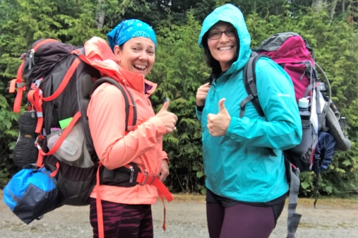 two women with backpacks going on a hike